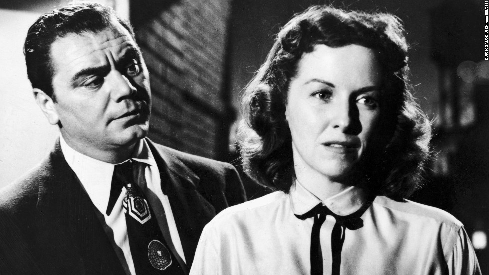 """Actress Betsy Blair stands with her back to Borgnine in a still from the film """"Marty,"""" directed by Delbert Mann."""