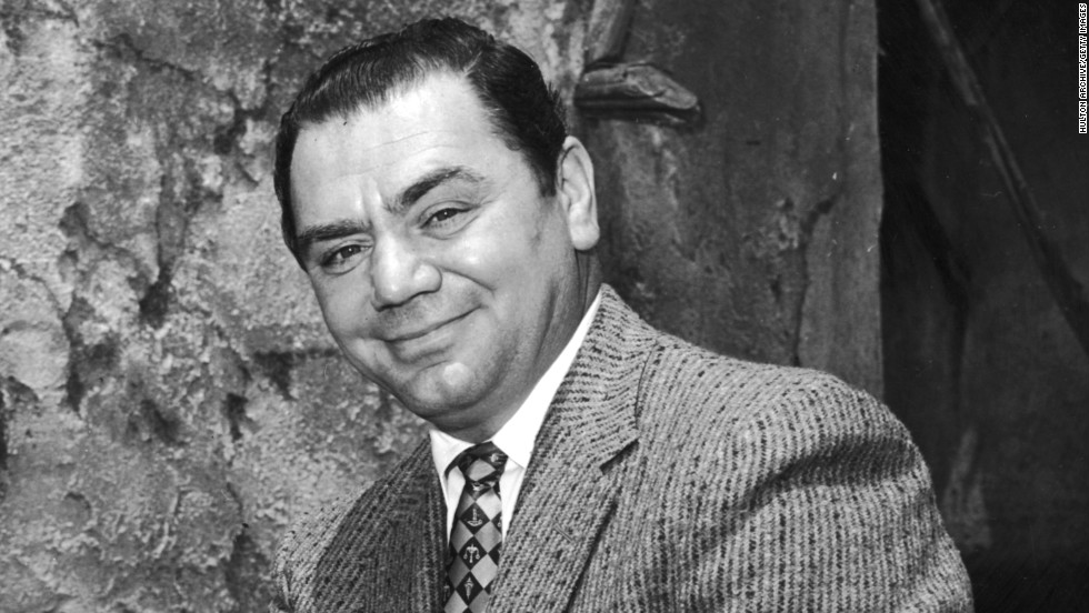 """Borgnine sits outdoors during the filming of Michael Curtiz's """"The Best Things in Life Are Free"""" in 1956."""