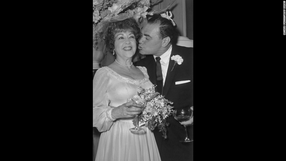 Borgnine leans in to kiss actress Ethel Merman during their 1964 wedding reception in Beverly Hills, California. They broke up in about a month and were officially divorced the next year.