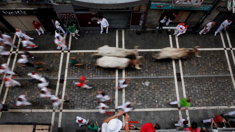Participants run along Estafeta Street in Pamplona on Sunday, July 8.