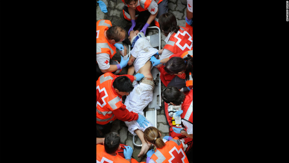 A man receives medical assistance after being injured during the first San Fermin Festival bull run.
