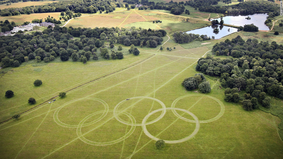 "With just days to go until the opening ceremony, organizers have cut Olympic rings into the grass in Richmond Park, south-west London, further promoting the green ambitions of the Games. David Stubbs, head of sustainability for London 2012 said: ""If you can put sustainability at the heart of a project which is the largest logistical exercise in peace time ... then you can do it anywhere."""