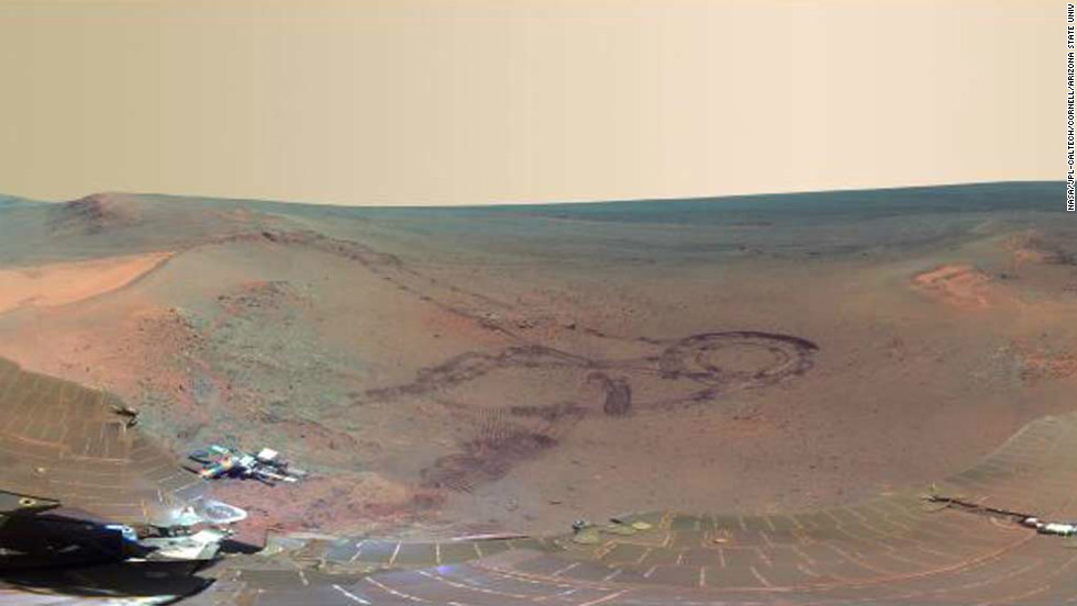 NASA has unveiled the latest panoramic view of Mars -- as seen by its venerable rover, Opportunity. The image shows an impact crater blasted billions of years ago, alongside fresh tracks created by the rover itself.