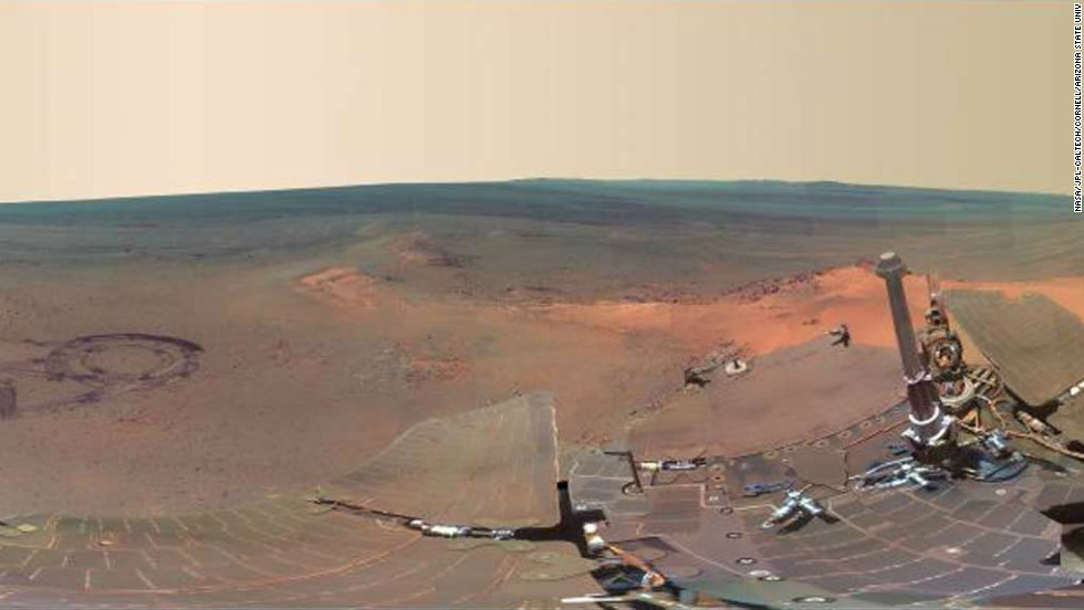 The 360-degree image is made up of 817 separate shots taken by Opportunity, which has been exploring Mars for more than eight years. The rover's own solar arrays can be seen in the foreground, with the martian landscape visible in the background.
