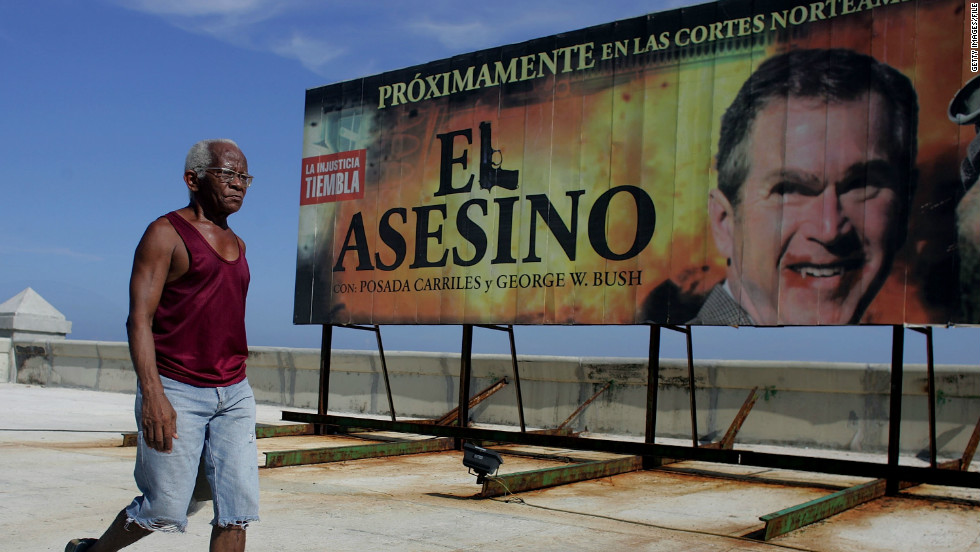 "A 2006 billboard in Havana reads ""Coming Soon to North American Courts: 'The Assassin' with Posada Carriles and George W. Bush."""