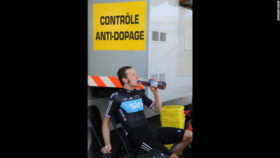 Stage winner Bradley Wiggins drinks before entering the anti-doping control bus at the end of the 41.5-kilometer Stage 9 individual time trial.