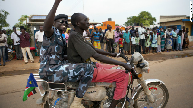 A South Sudanese policeman cheers on July 8 as people celebrate the eve of the country's independence day in Juba.