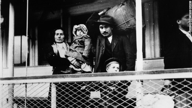 An Italian immigrant family on board a ferry from the docks to Ellis Island, New York.