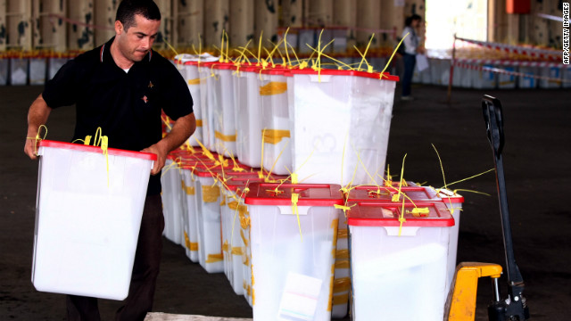 A High Election Commission worker collects ballot boxes from different polling stations to prepare for the final counting at Maatiga airport in Tripoli on July 8, 2012.