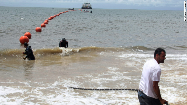 Technicians lay a fiber optic cable in October 2011 to allow Gabon and 22 African countries to get an Internet connection.