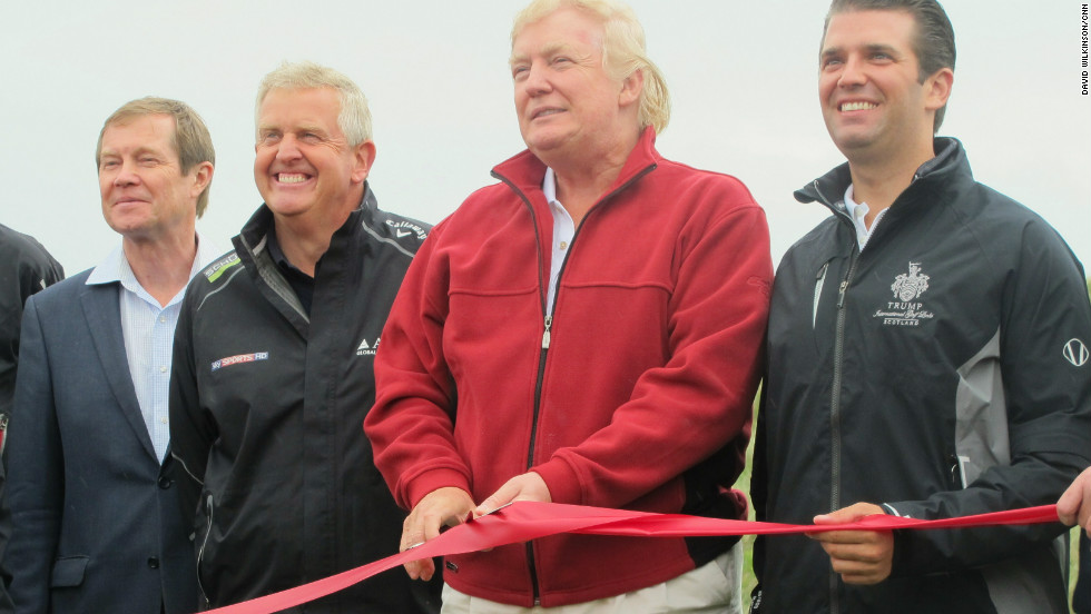 Trump (second from the right) cuts the ribbon at the grand opening of the Trump International Golf Links.