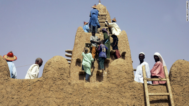 On April 10, 2006, residents restore the City of 333 Saints' Great Djingareyber Mosque in Timbuktu. The Islamists controling northern Mali destroyed two tombs there Tuesday., witnesses said.