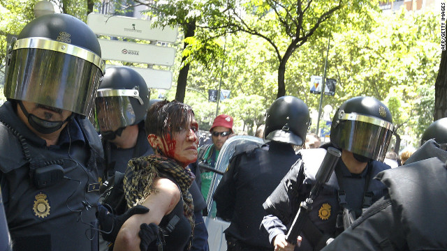 Police arrest a woman during clashes following a miners' demonstration in Madrid, on July 11, 2012.