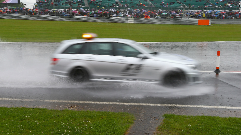 Formula One's British Grand Prix eventually began under clear skies but heavy rain prior to the race forced organizers to ask those with cars not to attend Saturday's qualifying session after camping areas and car parks became waterlogged.