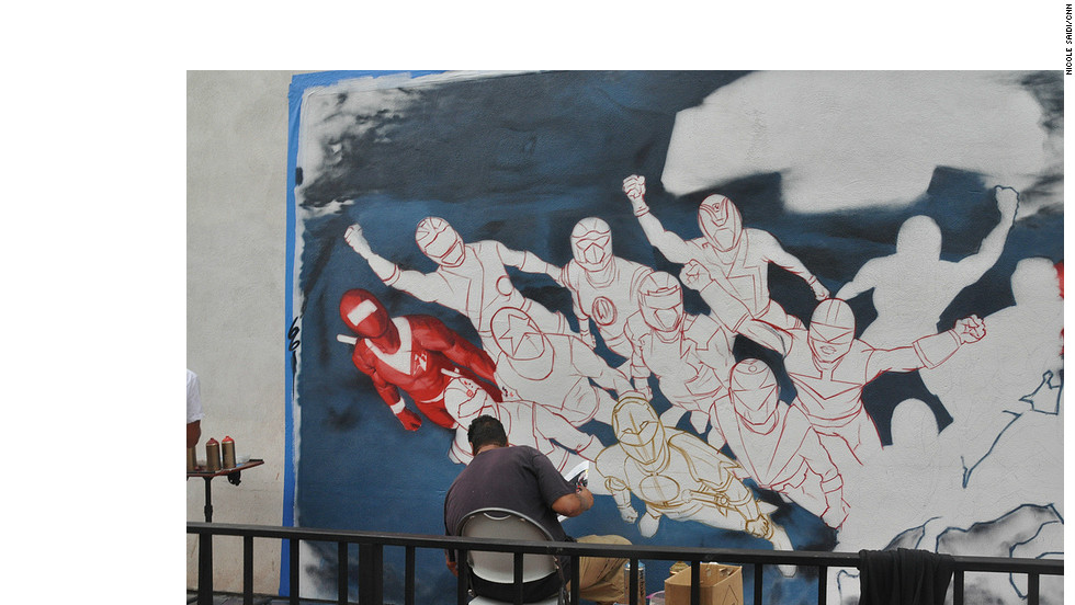 "Street artists worked quickly to finish a ""Mighty Morphin' Power Rangers"" mural."