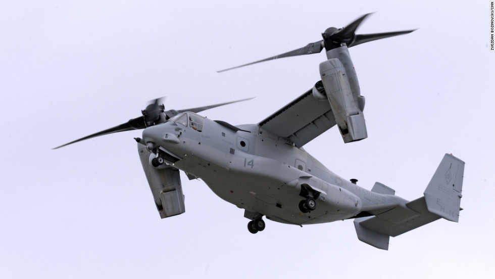 A U.S. Marines Bell Boeing MV-22 Osprey tiltrotor flies across the sky at Farnborough 2012.