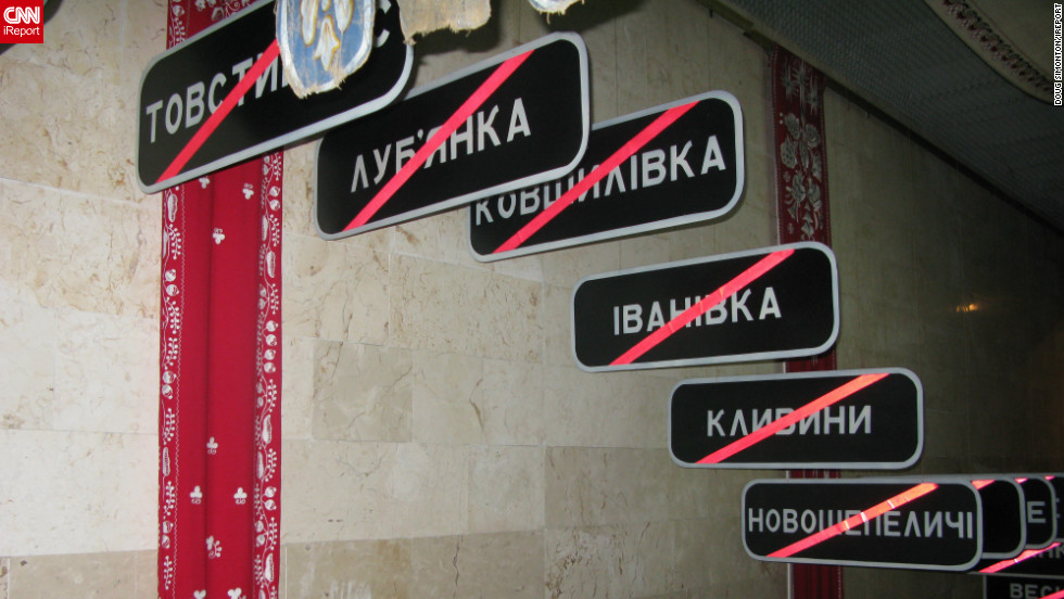 "These signs at the Chernobyl Musuem in Kiev act as a haunting reminder of ""just some of the towns and villages wiped off the map by the Chernobyl nuclear disaster in 1986,"" says Doug Simonton. Chernobyl would also have destroyed Kiev ""if the prevailing winds on 26 April 1986 had been blowing south vs. north,"" he adds."