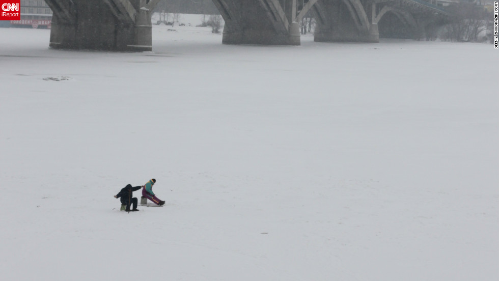 "Olexiy Zhivora took this photo on a snowy Kiev morning earlier this year. The image captures two children playing atop the frozen Dnieper River. ""Kiev is one of the most beautiful cities in the Eastern Europe but in the winter there is some special feeling about it,"" he says. ""The city itself becomes a true white palace."""