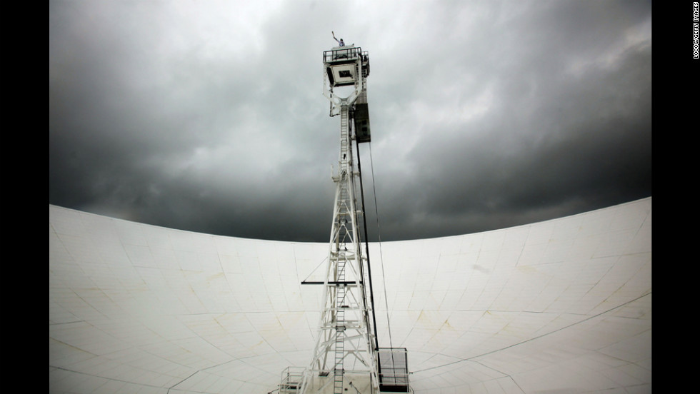 Comedian John Bishop carries the Olympic flame on top of the Jodrell Bank Observatory in Jodrell Bank, England, on May 31.