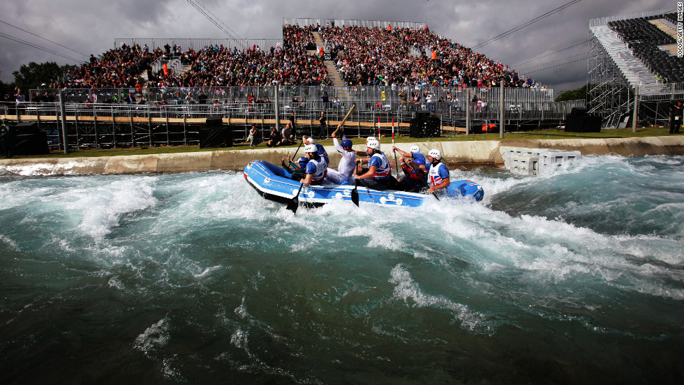 Competitive canoeist Zachary Franklin carries the flame at the Lee Valley White Water Centre in Waltham Cross, England, on July 7.