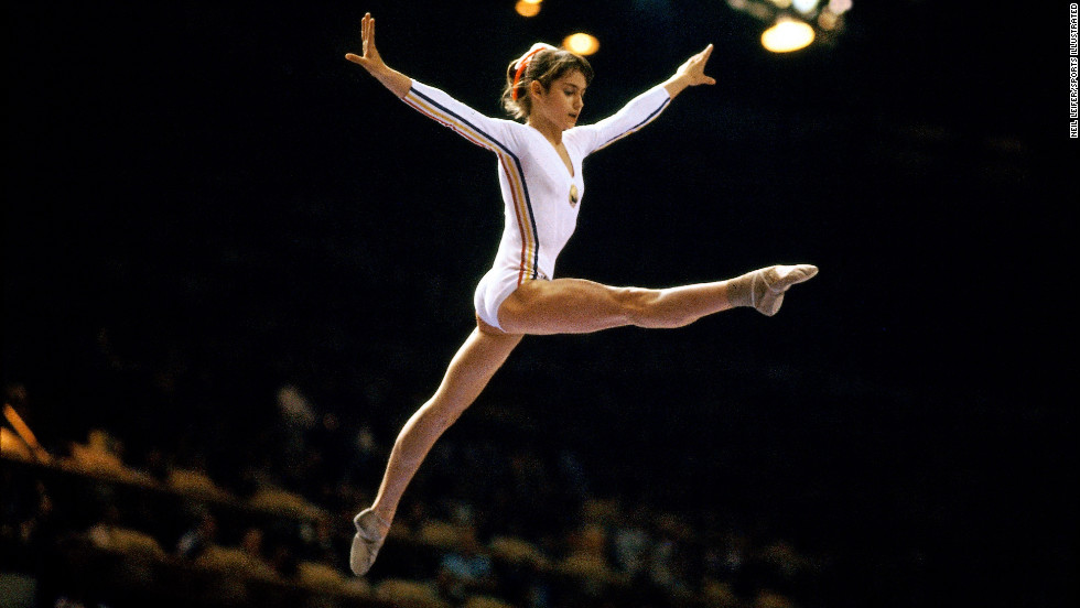 Famed sports photographer Neil Leifer dreamed of getting this shot of 1976 Olympic star Nadia Comaneci. Because of his determination, planning and excellent position in the gym, he did. The photo exemplifies the 14-year-old's performance at the 1976 games -- she was the first gymnast in Olympic history to be awarded the perfect score of 10. Perpendicular to the balance beam, Leifer cut out any other distractions and focused on Comaneci during a peak moment. She's practically dancing on air, performing against the dark curtain of the audience. It captures her grace beautifully and simply, and freezes her victory in time.