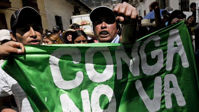 People shout slogans during a protest against US Conga mining project in Cajamarca, Peru on July 9, 2012.