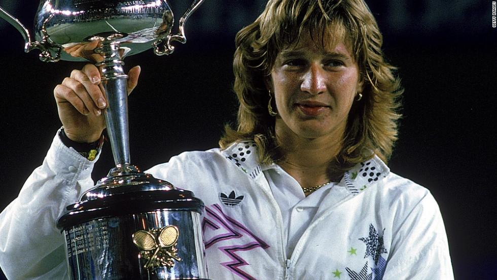 "Graf holds aloft the 1988 Australian Open title, the first leg of her ""Golden Slam"" that year."