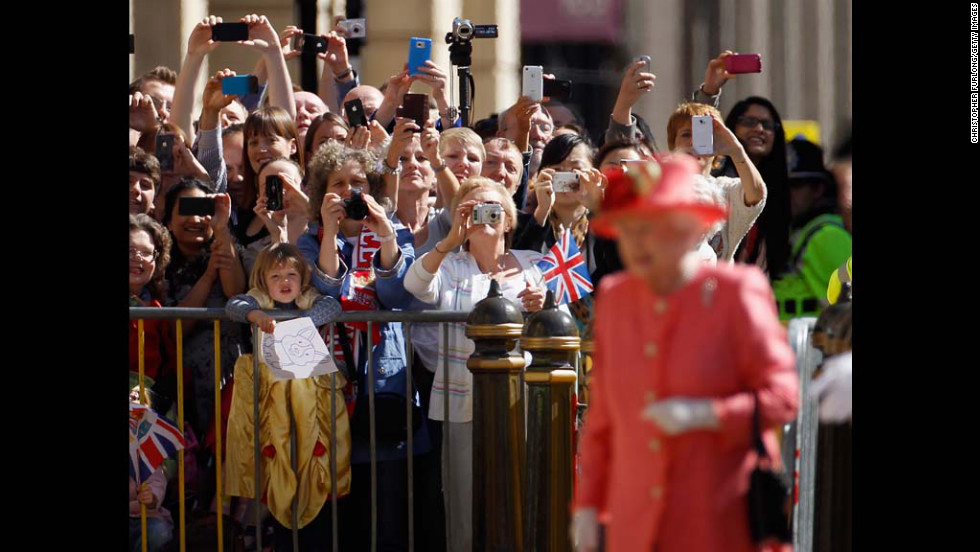 Well-wishers clamor to see Queen Elizabeth II at Victoria Square during her Diamond Jubilee visit to the Birmingham, England, on Thursday.