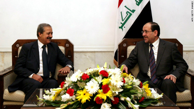 A handout picture dated November 4, 2010 shows Iraqi Prime Minister Nuri al-Maliki (R) meeting with Syria's ambassador to Iraq, Nawaf Fares, in Baghdad.