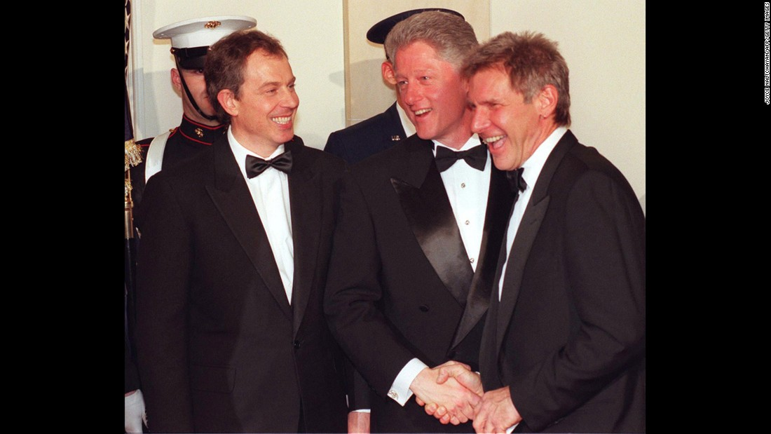 Ford is greeted by President Bill Clinton and British Prime Minister Tony Blair during a state dinner at the White House in 2005.
