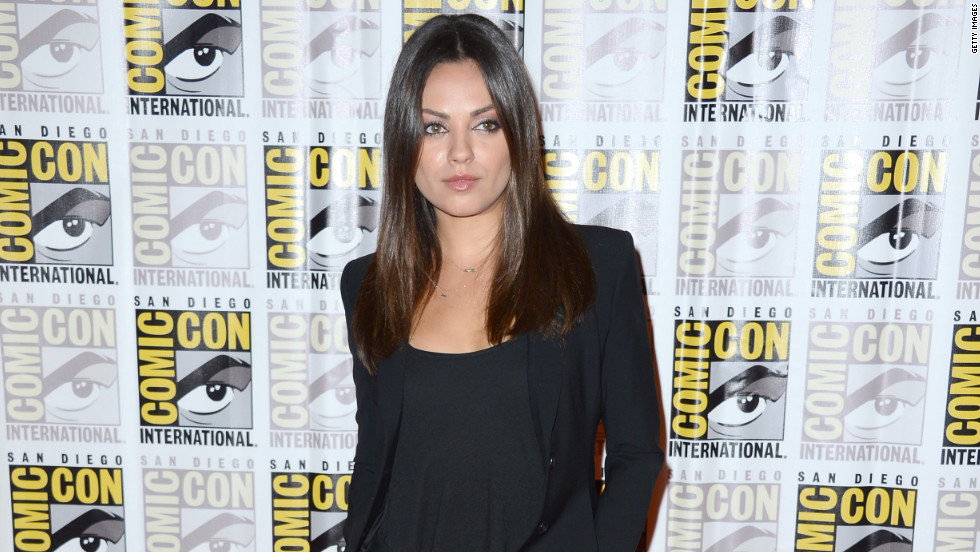 Mila Kunis poses for pictures at Comic-Con in San Diego.