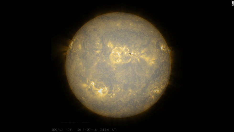 Sunspots, which are cooler, darker areas of intense magnetic activity, are most often the source of solar storms. Here the sun's lower atmosphere is observed in extreme ultraviolet light July 17 and 18, 2011.