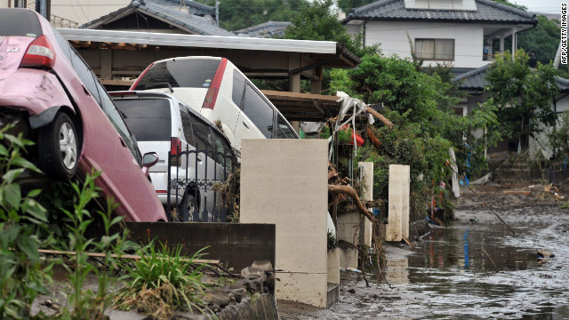 Cars pile up in Japan's southern island of Kyushu after the heaviest rainfall on record for the area.