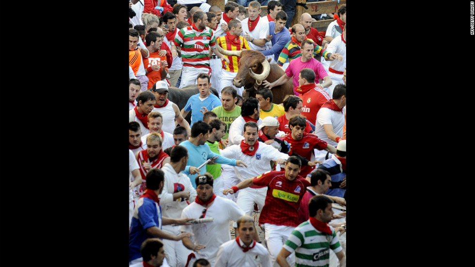 Participants run in front of Don Juan Pedro Domecq's bulls on Friday.