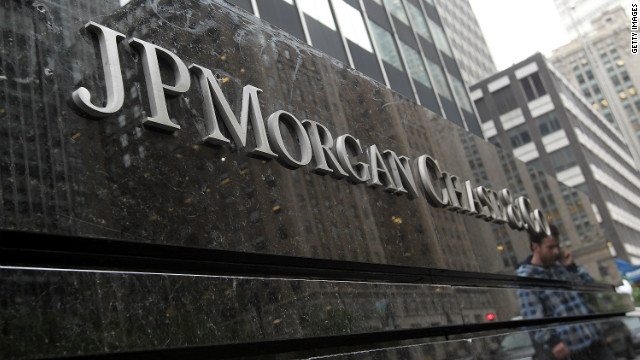 A man is reflected in a sign outside of JPMorgan Chase headquarters on May 14, 2012 in New York City.