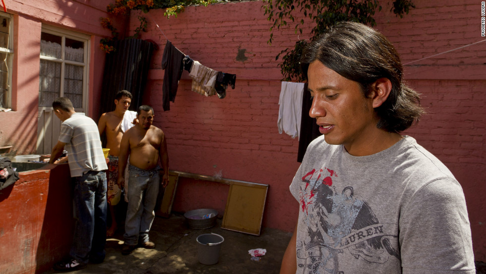Church officials say more than 100 Central American immigrants pass through the Lecheria neighborhood daily. Neighbors called for this shelter housing them to shut down.