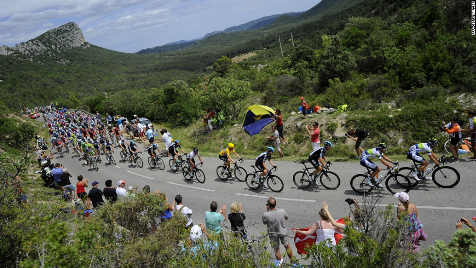 Fans cheer on cyclists participating in the 2012 Tour de France on Saturday, July 14.
