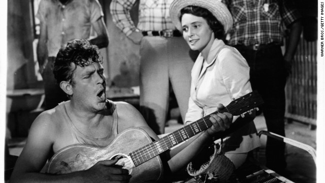 "Andy Griffith plays guitar as Patricia Neal watches in a scene from the 1957 film ""A Face In The Crowd."""