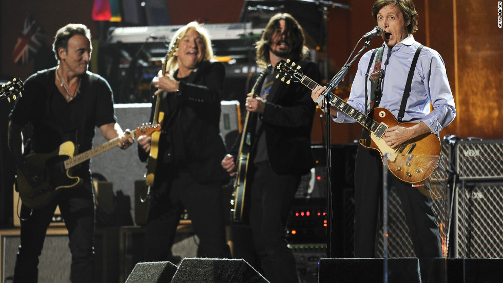 "He was joined for the finale by Beatles legend Paul McCartney. The two, seen here with Joe Walsh and Dave Grohl at the Grammys in February, played ""I Saw Her Standing There"" and ""Twist and Shout"" before the power was pulled by concert organizers."