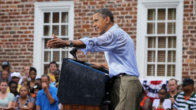 Barack Obama speaks to supporters in the rain during his ''A Vision for Virginia's Middle Class'' campaign event July 14, 2012 at Walkerton Tavern in Glen Allen, Virginia.