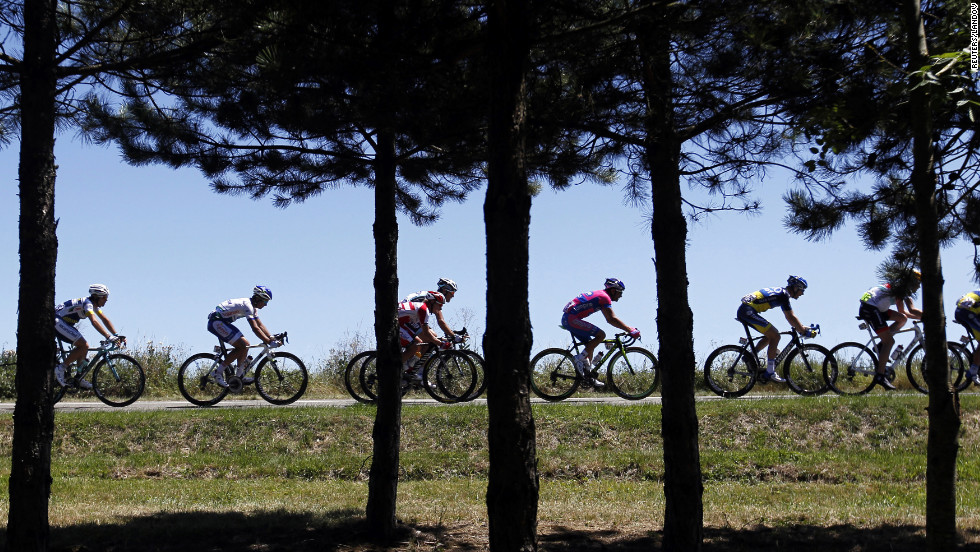 The main pack of riders pass through the French countryside during Monday's course.