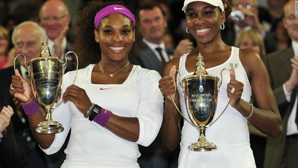 By defending her Stanford title on Sunday, Serena Williams (left) equaled her older sister Venus'  record of 43 WTA  tournament victories, the most by any player still active on the Tour.  Former world No. 1 Serena retained her ranking of fourth, achieved by winning her fifth Wimbledon title this month. She also won the doubles with Venus.