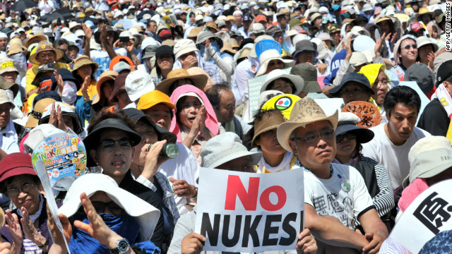 People hold placards to protest against nuclear power plants in Tokyo on July 16, 2012.