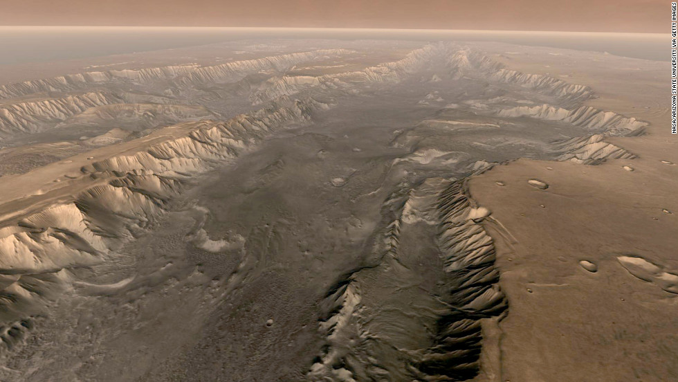 The Valles Marineris rift system on Mars is 10 times longer, five times deeper and 20 times wider than the Grand Canyon. This composite image was made from NASA's Mars Odyssey spacecraft, which launched in 2001.