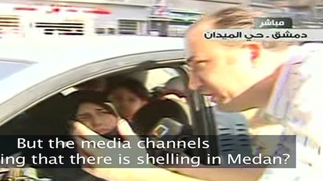 Gunfire interrupts Syrian state TV report