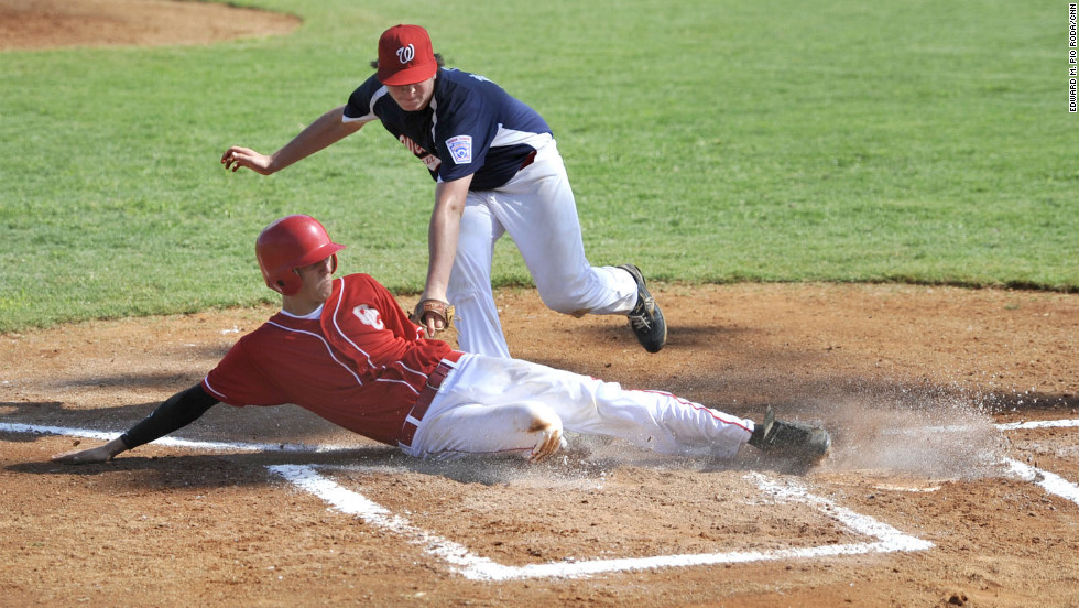 When shooting sports like baseball, be prepared for action to occur in certain areas, such as home plate, and pre-set your focus and exposure.