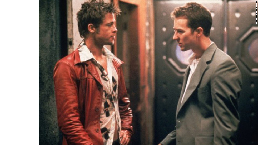 "When the insomniatic narrator (Edward Norton) meets soap salesman Tyler Durden (Brad Pitt) at a bar, he engages him not only in conversation about consumerism but also in a fistfight. The two become become friends and roommates, continuing to brawl and soon forming a ""fight club"" that acts as a sort of therapy for the many men who join the rogue organization. But Tyler isn't who the audience thinks he is: he and the narrator are actually the same person — dissociated personalities in the same body. To stop his mental projection, the narrator eventually shoots himself in the mouth, putting an end to Tyler and his anti-material schemes."