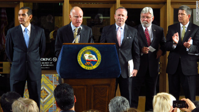 California Gov. Jerry Brown speaks Wednesday in Los Angeles before signing a bill to create a high-speed rail project.