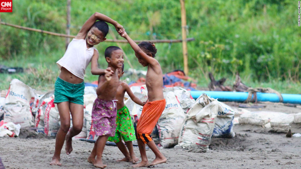 "Regardless of the weather not cooperating, <a href=""http://ireport.cnn.com/docs/DOC-814208"">iReporter Jim Heston captured this beautiful photo</a> of children playing from his day trip to Dala in Myanmar."