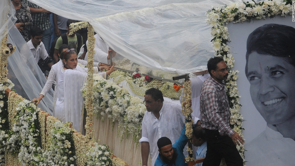 A float bearing the coffin of Rajesh Khanna is carried in a procession to the crematorium in Mumbai on Thursday, July 19.